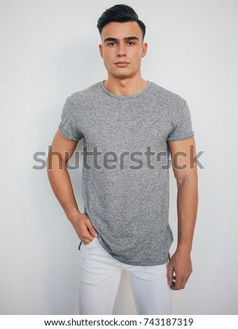 caucásico · hombre · azul · camiseta · de · moda - foto stock © zdenkam