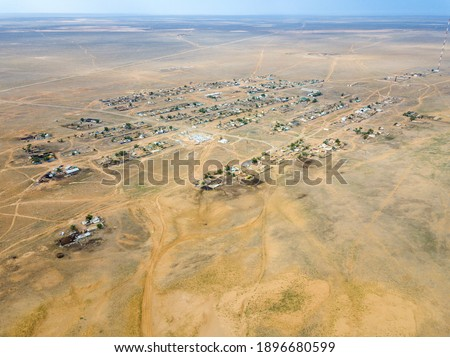 Aerial view of the old abandoned estate in the desert winter lan Stock photo © vlad_star