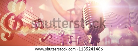 Close-up of microphone  against people with arms raised at nightclub Stock photo © wavebreak_media