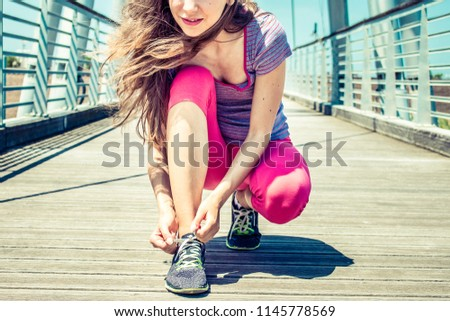 Woman doing shoelace tying in the park Stock photo © boggy