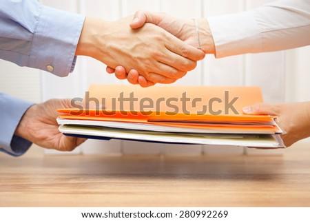 Businesswoman passing folder with documents to businessman vector illustration. Stock photo © RAStudio