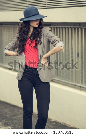 Image of glamorous curly woman 20s wearing casual clothes eating Stock photo © deandrobot