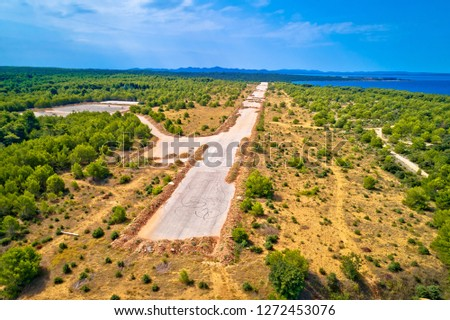 abandoned and destroyed airport runway in zadar sepurine aerial stock photo © xbrchx