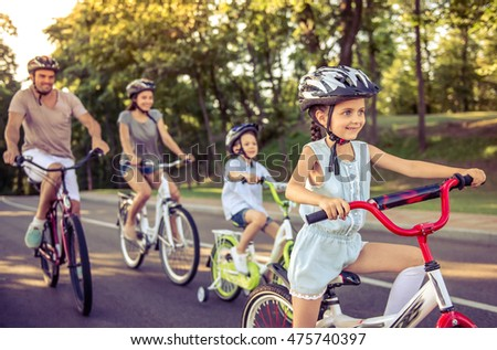 Happy family is riding bikes outdoors and smiling. Mom on a bike and son on a balancebike Stock photo © galitskaya
