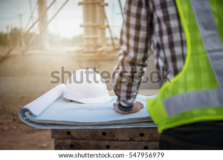 Architect supervising work on the construction site of a building Stock photo © Kzenon