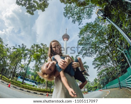 happy family makes selfie in the background of the Minar tower in Kuala Lumpur Stock photo © galitskaya