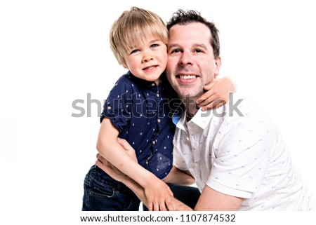 A Father and his five years blond son together isolated on white Foto stock © Lopolo
