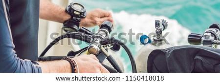 Diver prepares his equipment for diving in the sea BANNER, long format Stock photo © galitskaya
