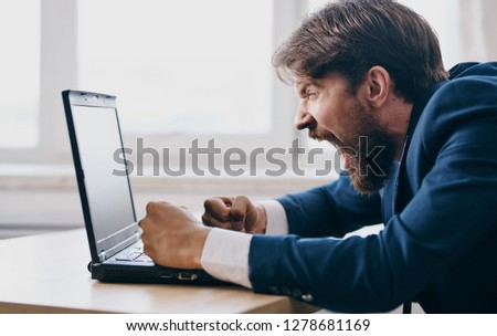 impulsive man with open mouth looks into the laptop in the office. Stock photo © ElenaBatkova
