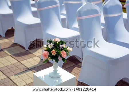 rows of chairs in white capes for guests at a wedding ceremony event outside Stock photo © ruslanshramko