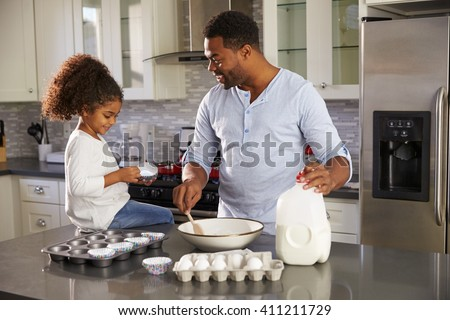 Front view of concentrated African American girl baking cookies in kitchen at home Stock photo © wavebreak_media