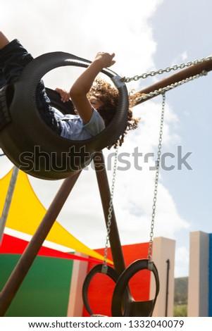 вид сбоку школьница играет Swing школы площадка Сток-фото © wavebreak_media