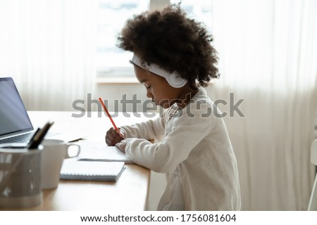 Side view of a mixed-race sad schoolgirl sitting alone on floor with her head on her arms crossed in Stock photo © wavebreak_media