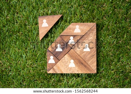 Tangram Square Block With Human Figures On Green Turf Background Stock photo © AndreyPopov