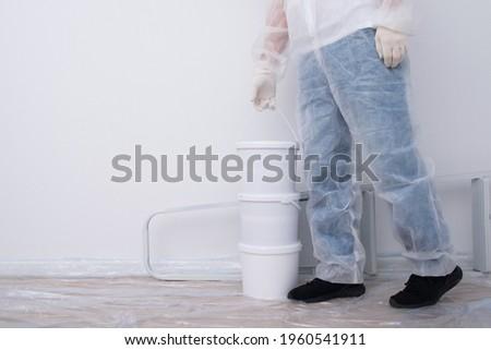 Paint tools against white background. Paintbrush, roller in tray for refurbishing walls. Modern deco Stock photo © vkstudio