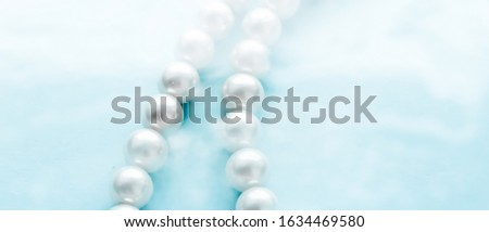 Coastal jewellery fashion, pearl necklace under blue water backg Stock photo © Anneleven