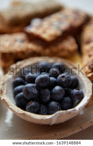 Close up of blackberries. With various energy nutrition bars in background Stock photo © dash