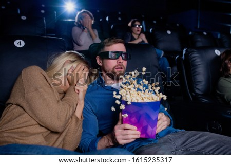 Scared girl covering face with hand while keeping head on shoulder of guy Stock photo © pressmaster
