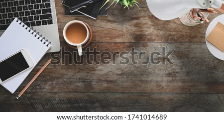 Wooden table with lamp, plant in pot, notebook with pen and other stuff Stock photo © pressmaster