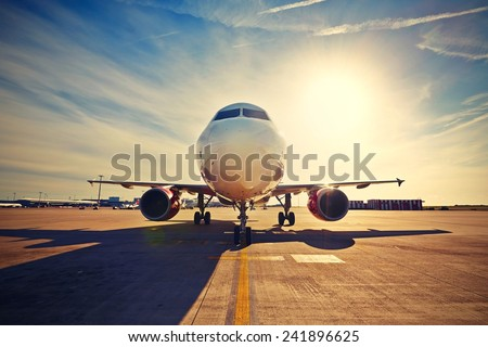 Airport terminal building and landing aircraft on landing strip, Stock photo © gomixer