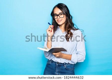 Görüntü genç kadın yazı aşağı notlar günlük Stok fotoğraf © deandrobot