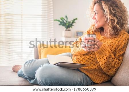 Kép nő kanapé otthon napló könyv Stock fotó © deandrobot
