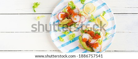 Banner of Salmon red caviar in bowl and Sandwiches with on wooden cutting board Stock photo © Illia