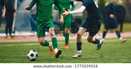 Soccer football players competing for ball and kick ball during  Stock photo © matimix
