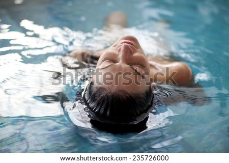 Young woman relaxing outside at a health spa by a swimming pool while having a massage BANNER, LONG  Stock photo © galitskaya