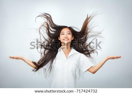 Imagem positivo belo asiático menina longo Foto stock © deandrobot