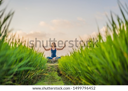 Young woman practice yoga outdoor in rice fields in the morning during wellness retreat in Bali. Vie Stock photo © galitskaya