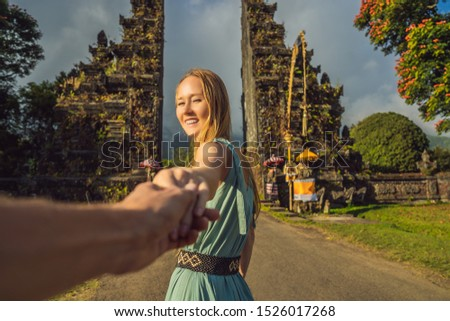 Tourist woman walking through Traditional Balinese Hindu gate Candi Bentar close to Bedugul, Bratan  Stock photo © galitskaya