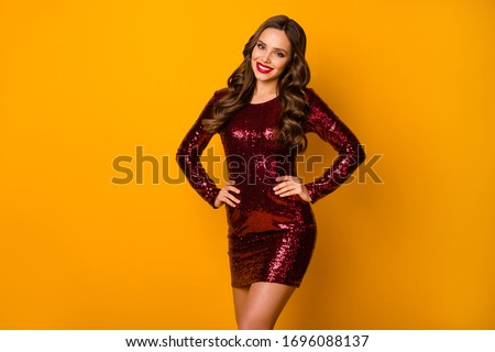 Happy positive woman in bright sequins dress wearing christmas hat. Stock photo © deandrobot