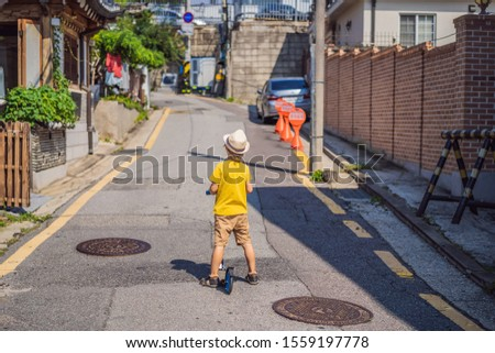 Boy tourist in Bukchon Hanok Village is one of the famous place for Korean traditional houses have b Stock photo © galitskaya
