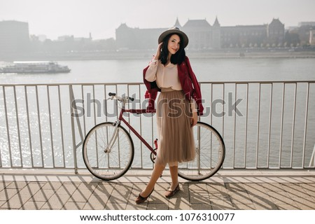 Photo of good looking woman with dark hair, spends leisure time with jack russel terrier dog, loves  Stock photo © vkstudio