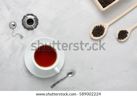 Black tea with natural flavors and a teapot. Top view on white background Stock photo © butenkow