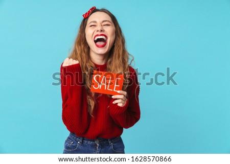 Kép izgatott szőke nő tart plakát készít Stock fotó © deandrobot