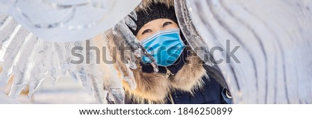 beautiful smiling young woman among the ice in wintertime outdoor. Winter concept Stock photo © galitskaya