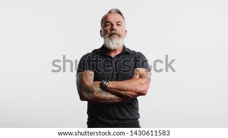 Komoly férfi tetoválás kar fehér póló Stock fotó © ruslanshramko