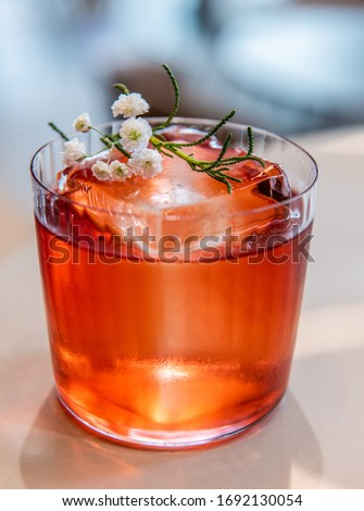 Negroni Cocktail in modern glass with ice cubes and orange slices with straw and half of fresh orang Stock photo © DenisMArt