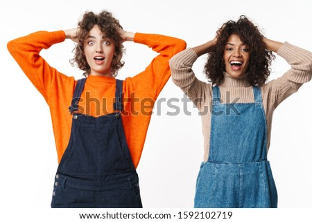 Portrait of delighted multinational women grabbing their heads Stock photo © deandrobot