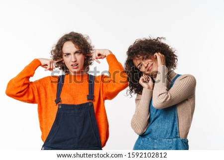 Portrait of nice multinational women plugging their ears Stock photo © deandrobot
