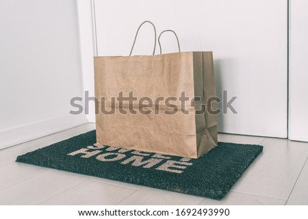 Home delivery of food grocery bag left at door mat for Corona virus spreading safety. Precaution mea Stock photo © Maridav