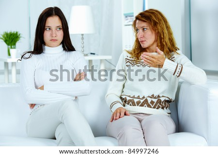 Photo of irritated caucasian woman talking and looking at camera Stock photo © deandrobot