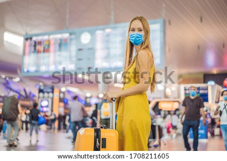 Start of her journey. Beautiful young woman in medical mask ltraveler in a yellow dress and a yellow Stock photo © galitskaya