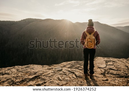 Woman hiker on a rock. View of the valley from the cliff, Vietnam, Da Lat Stock photo © galitskaya
