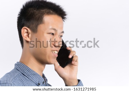 Close up of a handsome businessman making a phone call against a white background Stock photo © wavebreak_media