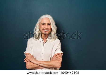 Portrait of a gorgeous businesswoman posing with the arms crossed against a white background stock photo © wavebreak_media
