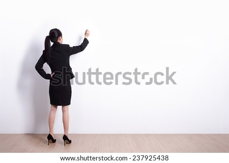 Stock photo: A business woman writing something isolated on white background.