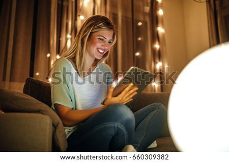 gülen · genç · kadın · ev · gece · kadın - stok fotoğraf © hasloo